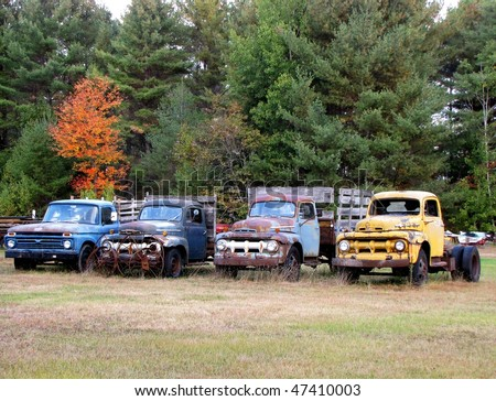 Four derelict trucks in a row. - stock photo