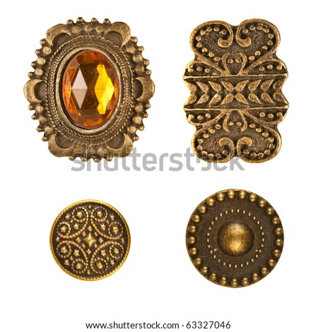 Four different medieval bronze buttons arraged on white - stock photo