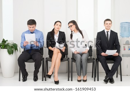 Four different people waiting for interview. Looking nervous  - stock photo