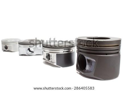 Four different piston on white background - stock photo