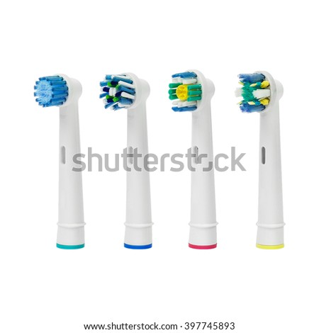 Four different replacement brush heads for electronic toothbrush isolated on a white background. - stock photo