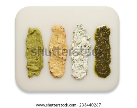 Four different sauces on plate - stock photo