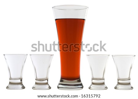 four empty shots and one full beer glass - stock photo