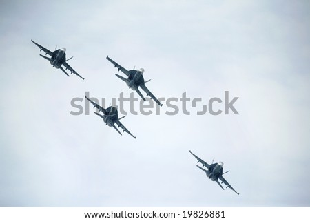 Four F/A-18 Hornet conduct a maneuver in the air during a show - stock photo