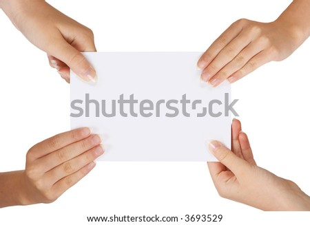 Four female hands holding a white card with copy-space - stock photo