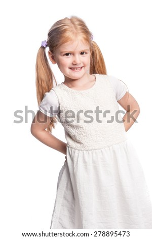 Four five year year old girl smiling in studio portrait. - stock photo