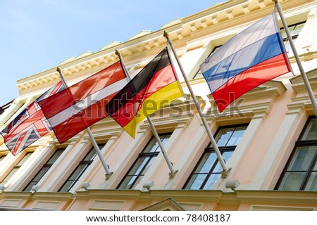 Four flags outdoors - stock photo
