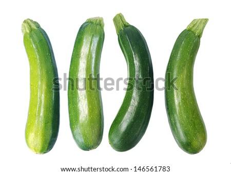 four fresh zucchini isolated on white  - stock photo
