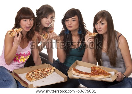 Four friends eating pizza - stock photo