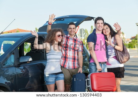 Four Friends Ready to Leave For Vacation - stock photo