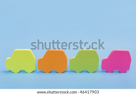 four funny colorful cars isolated on a blue background - stock photo