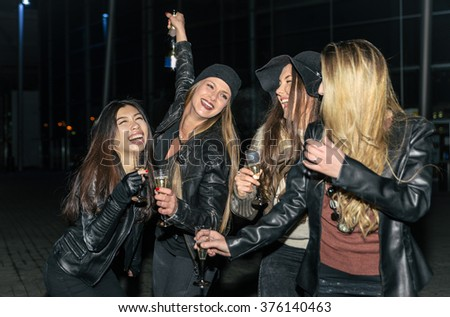 Four girls making party outdoor in the night - stock photo