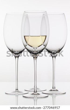 Four glasses of wine on the white background - stock photo