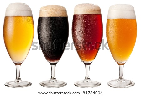 Four glasses with different beers on a white background. The file contains a path to cut. - stock photo