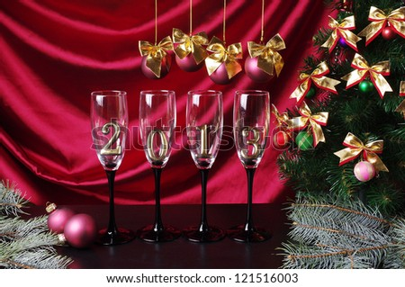 Four  goblets of champagne with numeral 2013 against purple drapery.  New Year decoration - stock photo