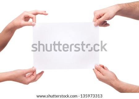 four hands holding a blank white board. isolated on white - stock photo