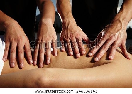 Four hands massage - stock photo