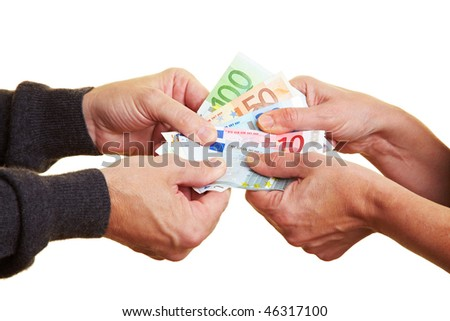 Four hands pulling hard on Euro banknotes - stock photo