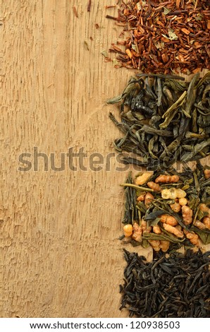 Four heaps of tea - stock photo