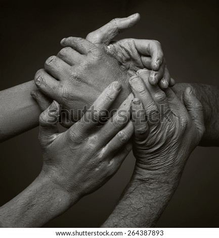 Four holding hands  - stock photo