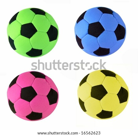 four images in one of four brightly colored stuffed toy soccer balls which could be used icons.  The colors are green, yellow, blue and pink and all are isolated over white. Colors could be changed - stock photo