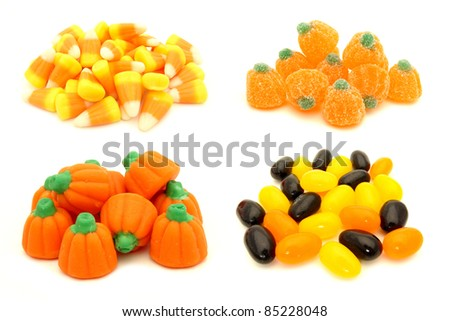 Four individual piles of Halloween candy - candy corn, gummy pumpkins, jelly pumpkins and jelly beans - stock photo