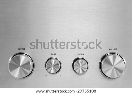 Four isolated gray hifi knobs from a stereo amplifier - stock photo