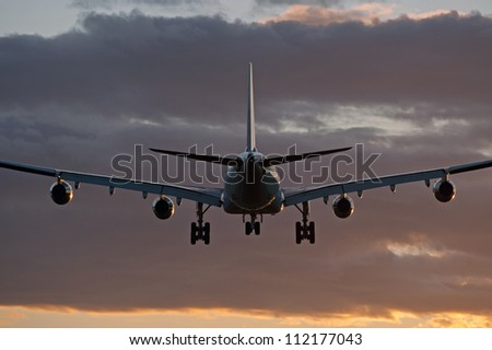 Four jet engine aircraft before landing - stock photo