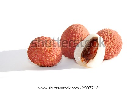 Four litchis - one peeled and cut, showing its seed - on white background - stock photo