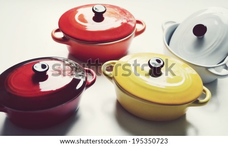 Four little colorful cooking pots for julienne - stock photo