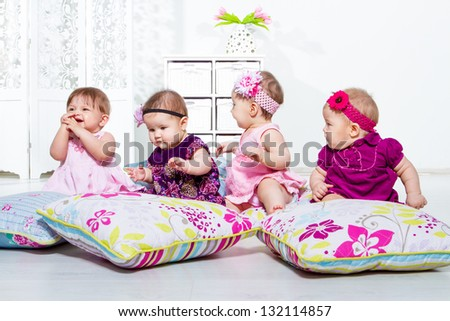Four little girls group sitting together - stock photo