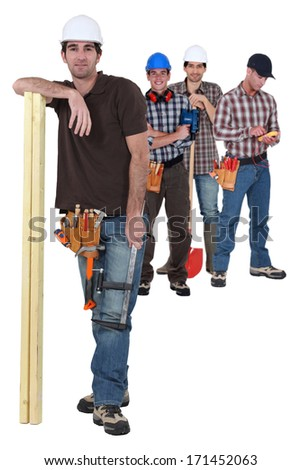 Four manual worker from different trades - stock photo