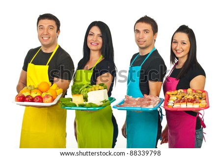 Four market workers standing in a line and holding their fresh products on plateau isolated on white background - stock photo