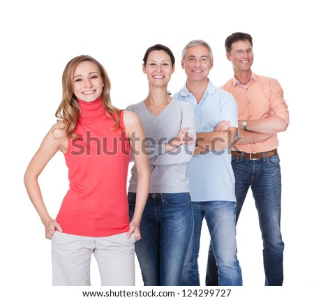 Four middle-aged attractive business associates or friends dressed in casual clothes standing in an oblique line - stock photo