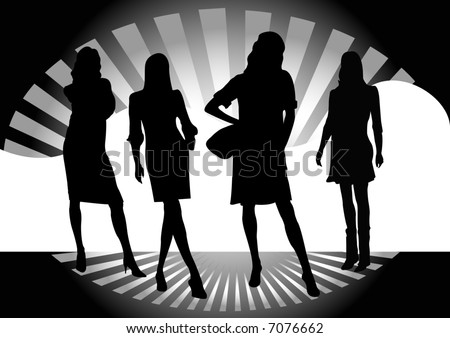 four models standing on catwalk runway with starburst pattern behind - stock photo