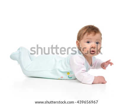 Four month Infant child baby girl lying on a floor isolated on a white background - stock photo
