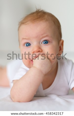 Four months old baby with blue eyes - stock photo