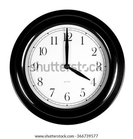 Four o'clock on the black wall clock, isolated on white background - stock photo