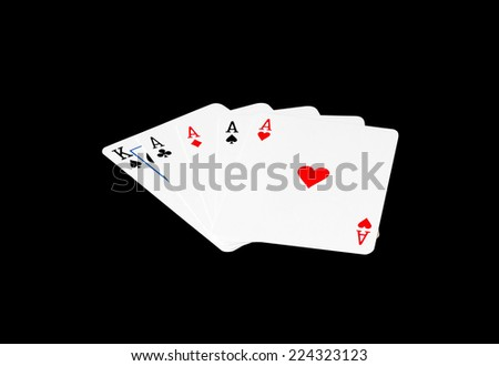 Four of ace & the king card in poker game on black background - stock photo