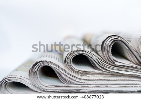 Four packs of newspapers. They are ready to distribution among readers. - stock photo