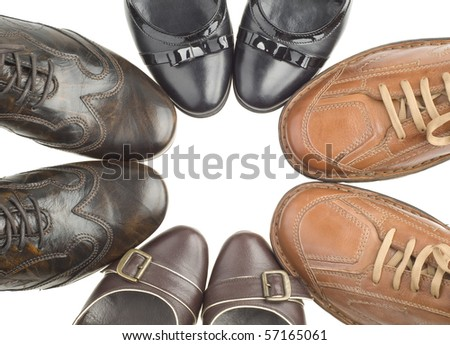 Four pairs of shoes on a white background - stock photo