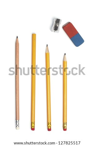 Four pencils with a sharpener and eraser rubber, isolated on white background - stock photo