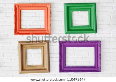 four photo frames on the white wall - stock photo