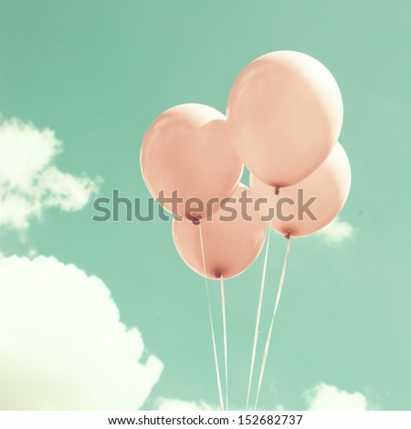 Four Pink Vintage Balloons Over Turquoise Sky - stock photo