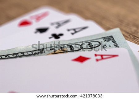 four poker aces with 100 dollar bills - stock photo