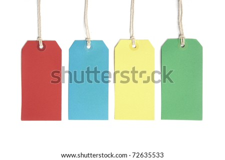 Four price or luggage tags coloured red, blue, yellow and green and isolated on white - stock photo