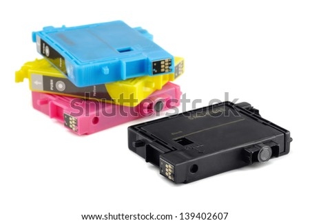 Four printer ink cartridges isolated on white - stock photo