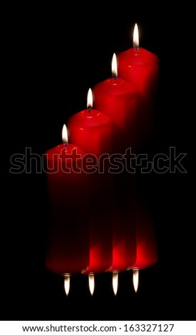 Four red candles reflected on dark background - stock photo