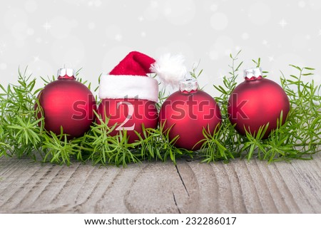 Four red christmas balls with christmas hat/christmas/christmas balls - stock photo