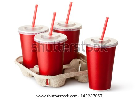 Four red takeout cups with a cup holder. Isolated on a white. - stock photo